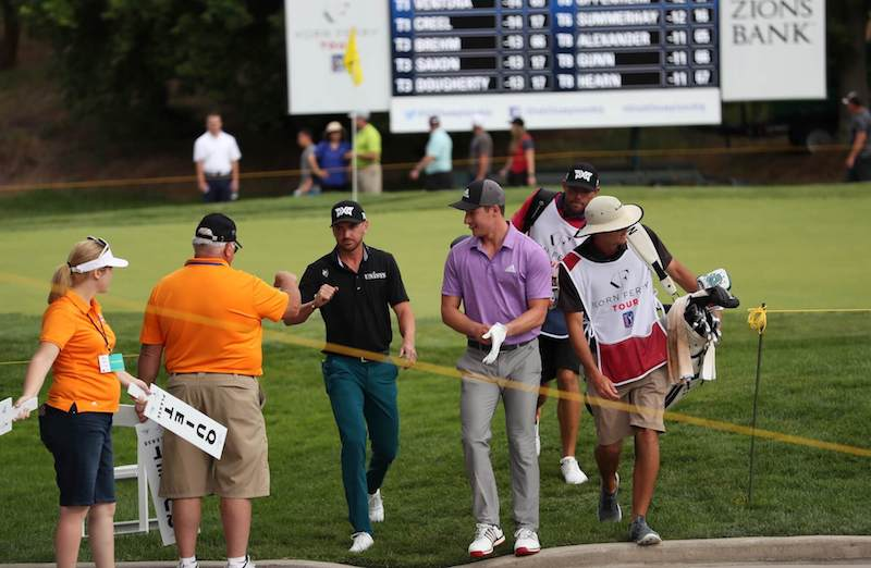 Kevin Dougherty fist bumps volunteer after 17th green