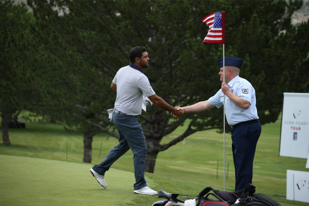 Hill Air Force Base tends the pin on 18th green