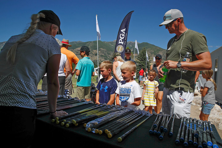 Utah Section PGA sizes up kids for a free golf club for the Kid's Clinic