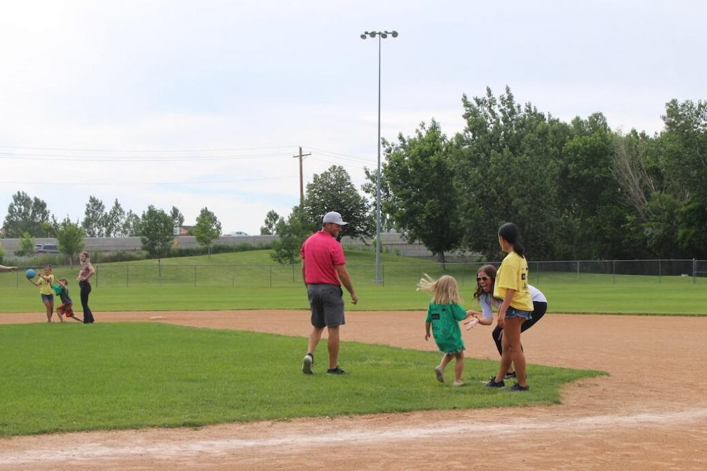 Player Sebastian Cappelen and Emily Summerhays cheer on first base run